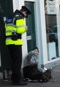 4-a-garda-takes-down-details-of-a-young-woman-begging-on-a-dublin-street